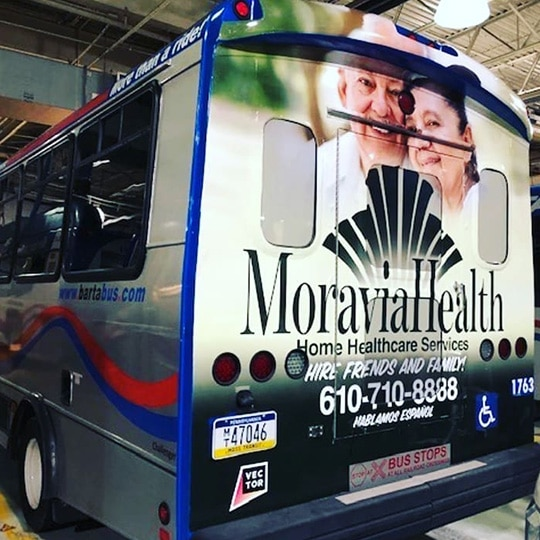 Moravia Health bus wrap advertisement